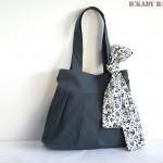 Moderno bolso gris con un lazo floral